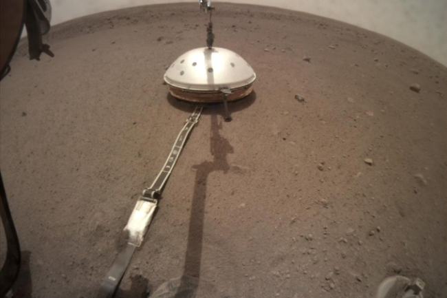 NASA s InSight lander has its seismic instrument tucked under a shield to protect it from wind and extreme temperatures.