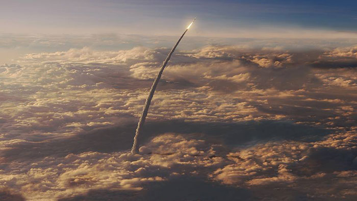 NASA Space Launch System SLS ascends through clouds